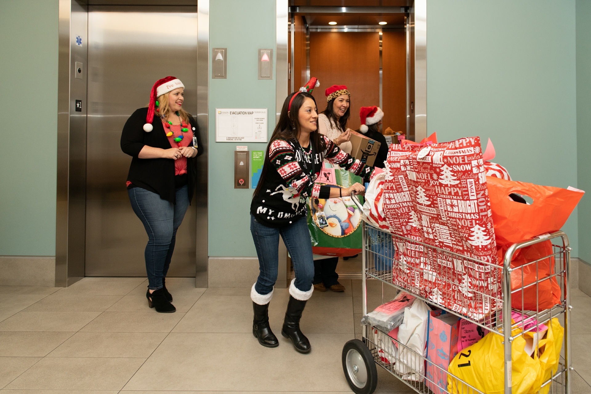 SCE employees in Pomona get ready to load gifts to deliver to McKinley Children's Center.