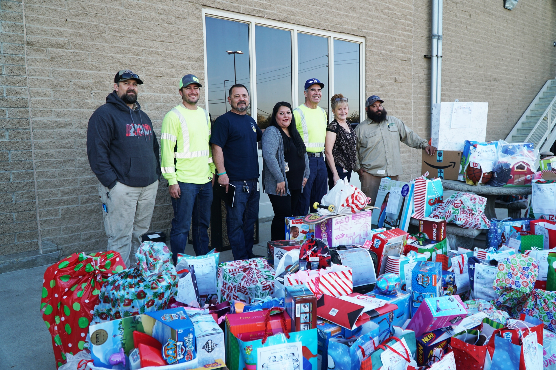 SCE employees at the Ontario Service Center donate toys to foster children at Specialized Care Foster Family Agency.