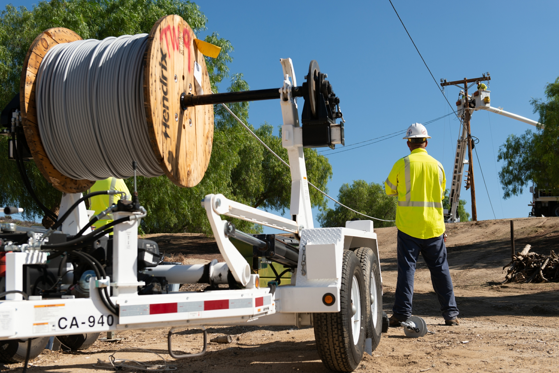 An SCE crew installs new insulated wires in Aguanga.