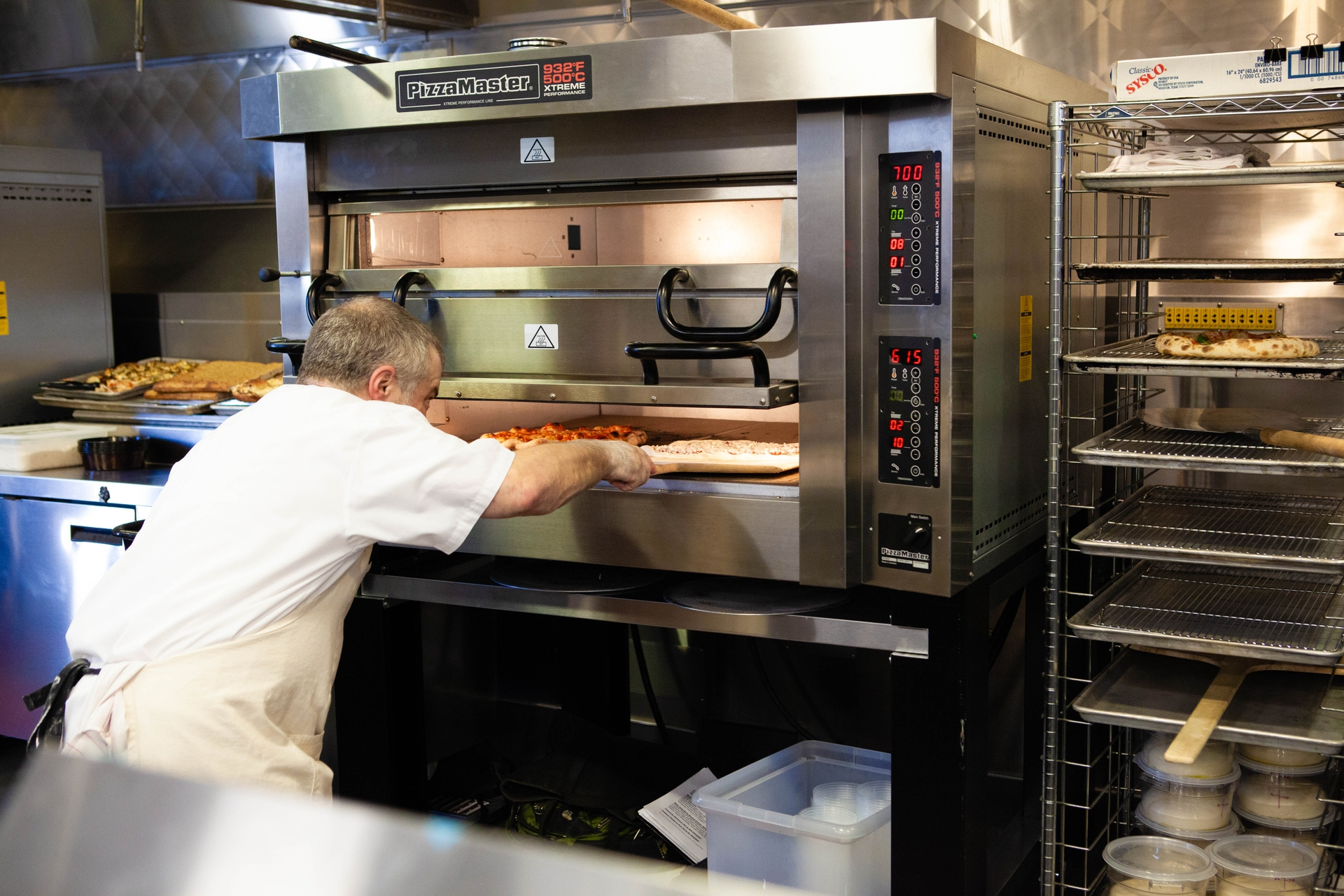 Pizza chef Noel Brohner checks pizzas in the new Pizzamaster ovens at SCE's Foodservice Technology Center.