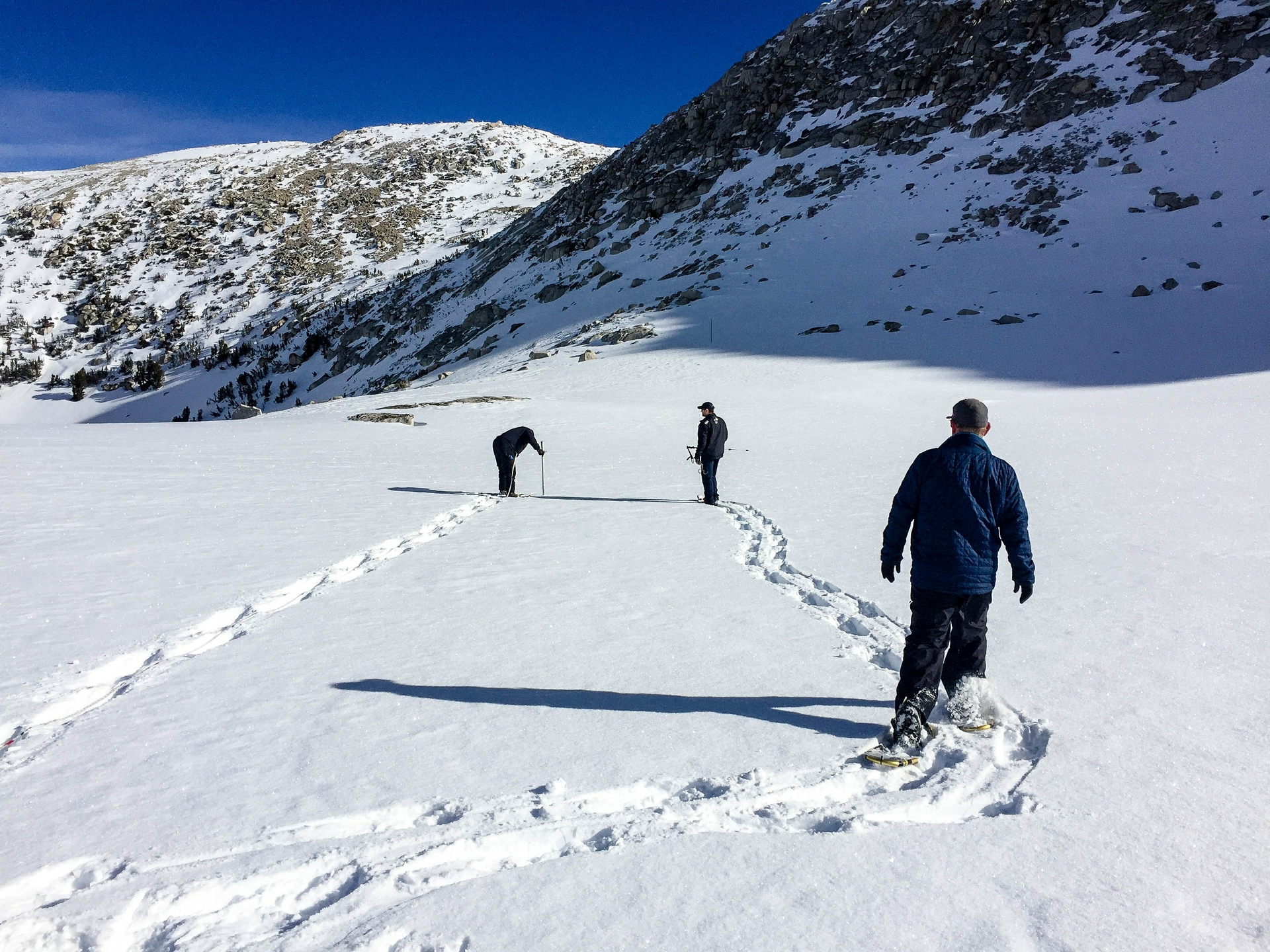 SCE's survey team treks in snowshoes to the Mono Pass snow course.