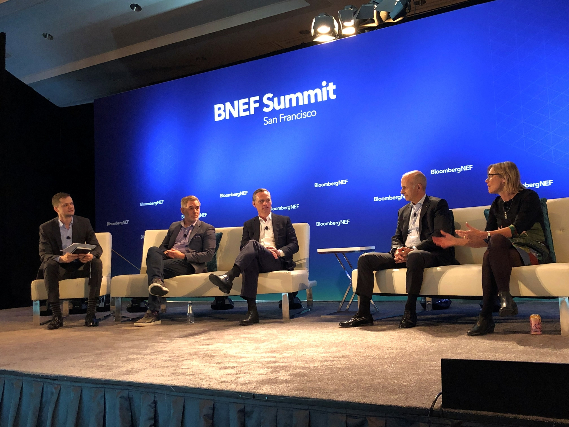 Edison International Senior VP for Strategy and Corporate Development Drew Murphy (center) discusses business models for EV charging at Bloomberg's Future of Mobility Summit in San Francisco.