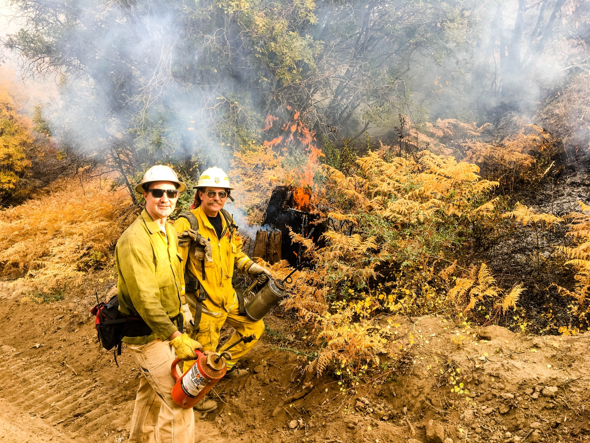 SCE Forester Ryan Stewart (left) and Cal Fire Battalion Chief Jim Fitzgerald work together to burn an area above Ely Meadow.