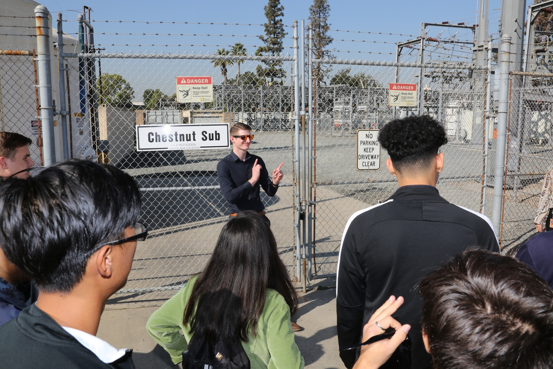 Cypress High School students listen as SCE Operations engineer Ryland Watts talks about the Chestnut Substation and the equipment stored there.
