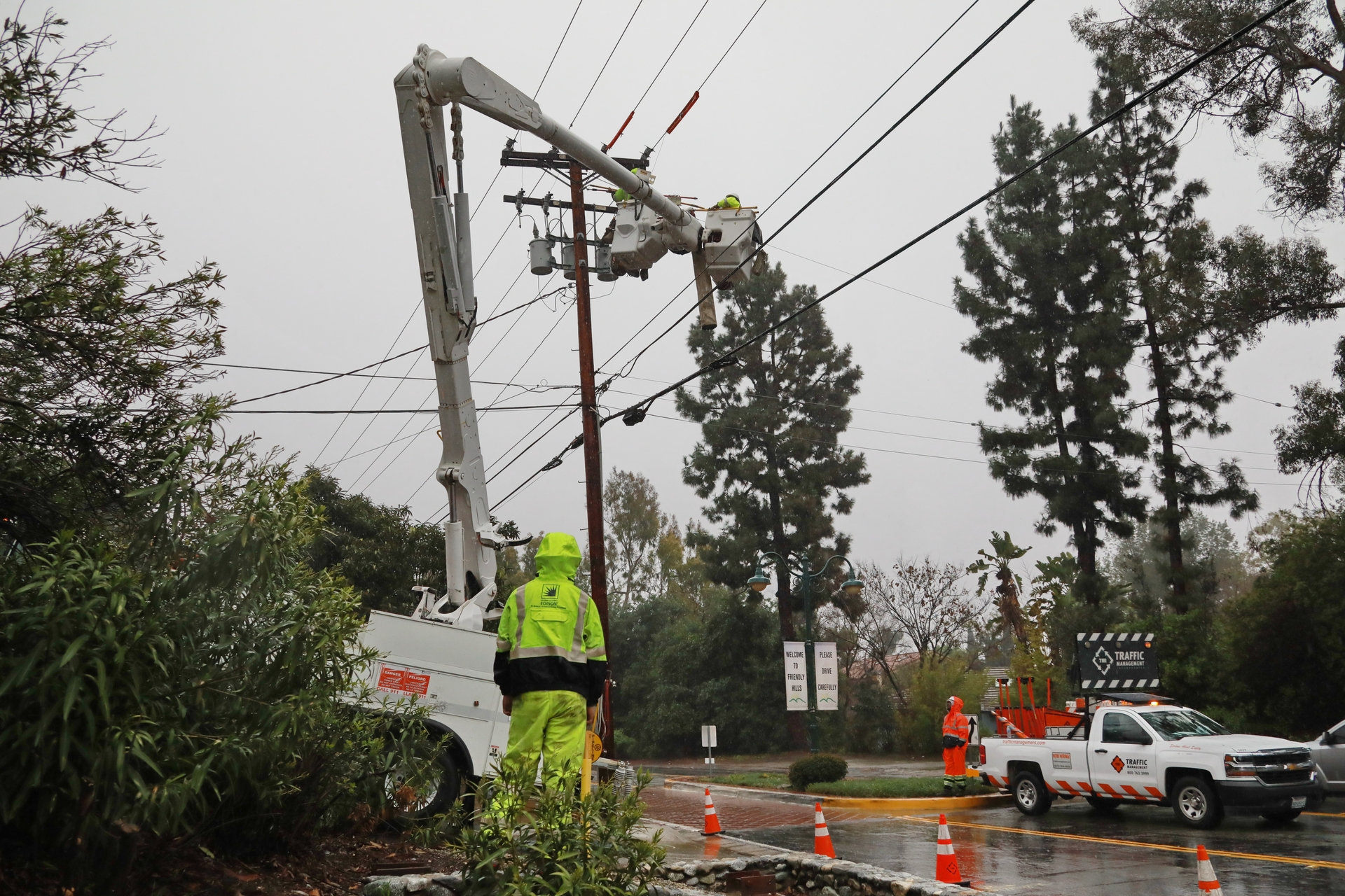 An SCE crew makes repairs during a recent rainstorm.