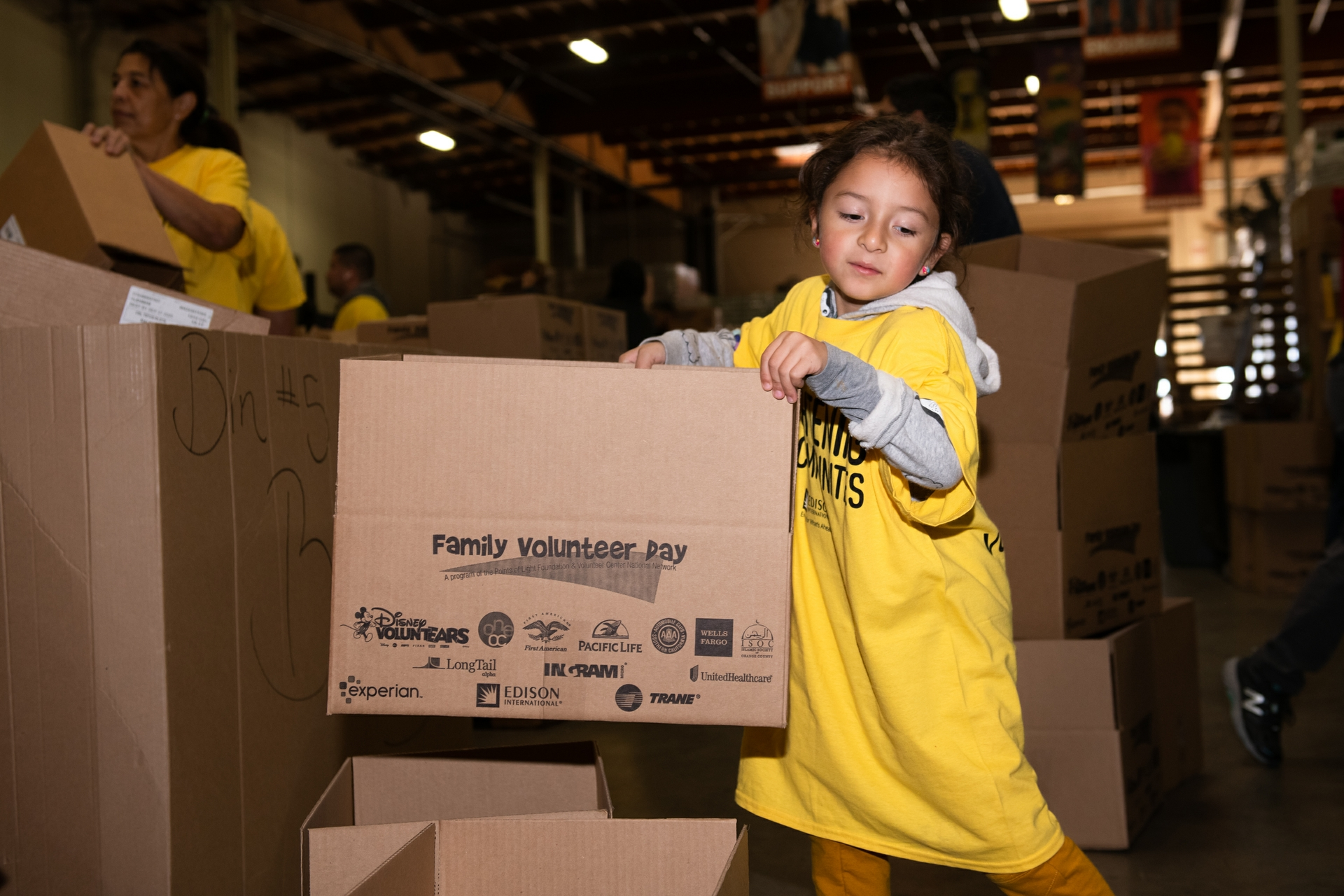 Cienna Valenzuela, 5, was among the youngest Edison volunteers helping out at the Orange County Food Bank.