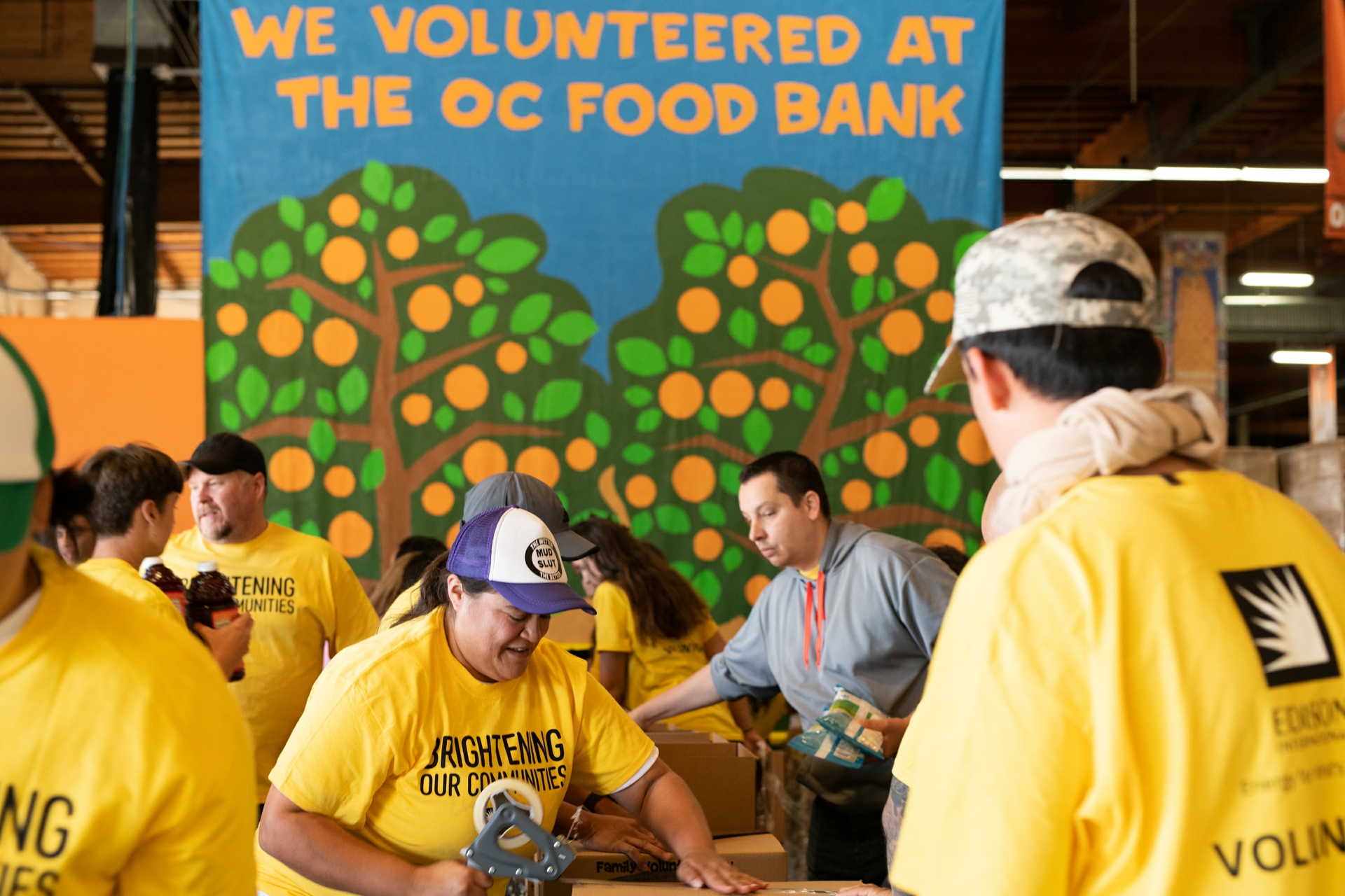 Edison volunteers seal food boxes at the Orange County Food Bank during National Family Volunteer Day.