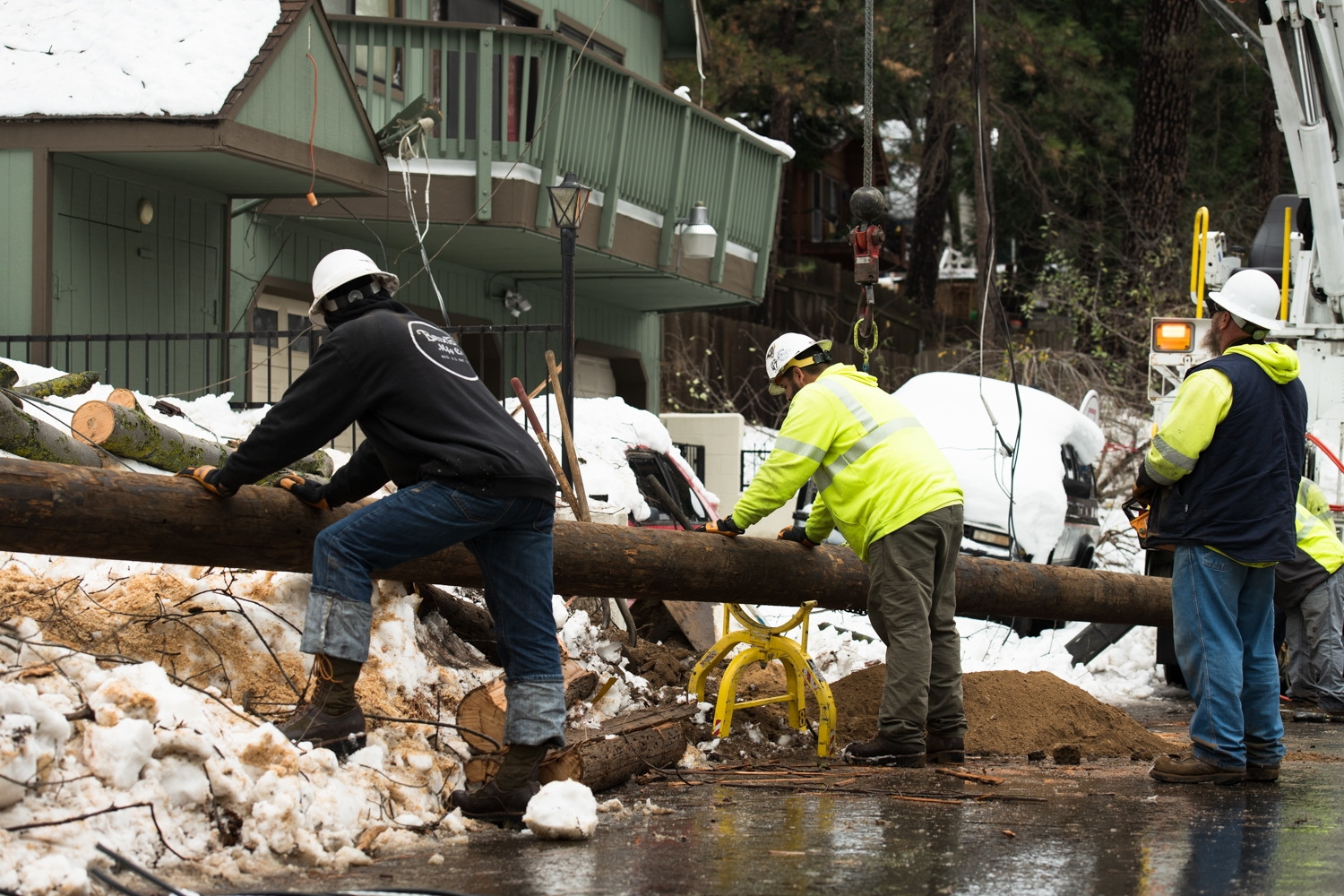 SCE crews prepare to replace a damaged power pole during restoration efforts after the Thanksgiving snowstorm in Lake Arrowhead.