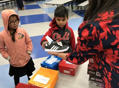 Edison Employees Donate Shoes to Needy Kids