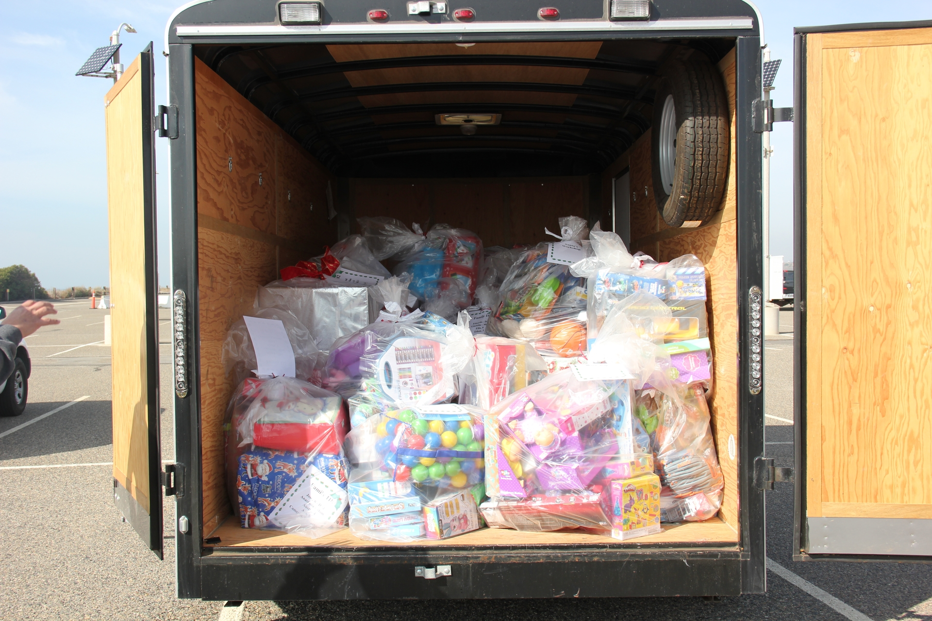 SCE employees load up a truck with Christmas gifts headed for Camp Pendleton.