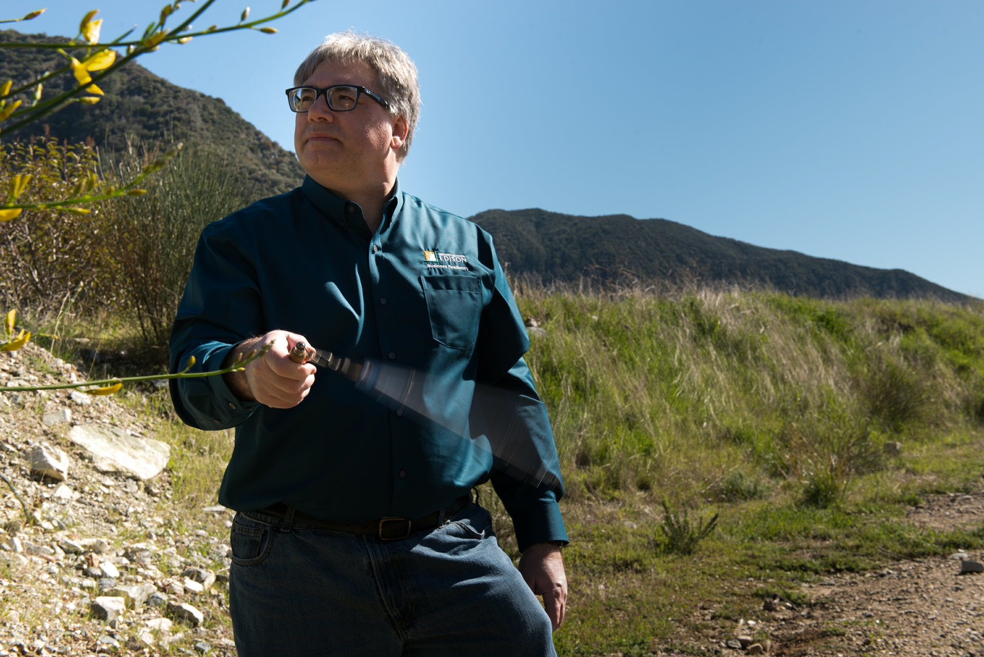 Tom Rolinski, SCE fire scientist, uses a sling psychrometer to measure the temperature and humidity.