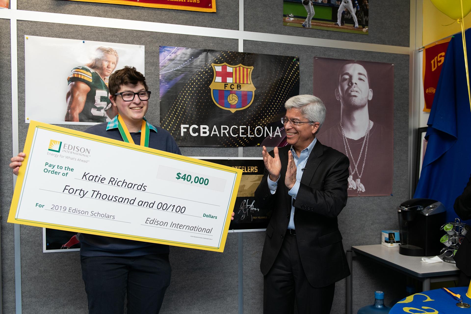 Pedro Pizarro, Edison International president and CEO, surprises Katie Sloan, 17, with an Edison Scholars award.