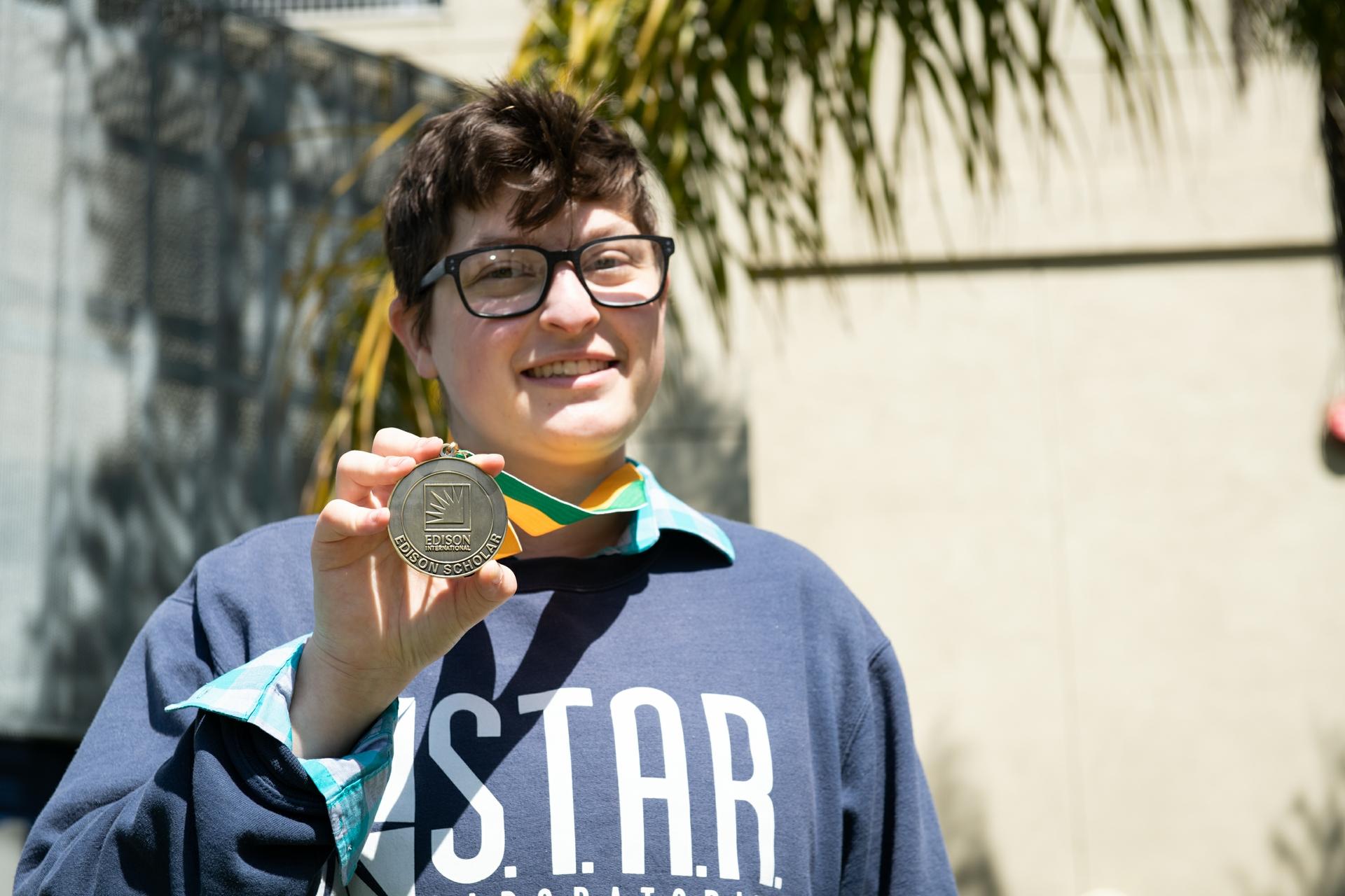 Katie Richards, a senior at Santa Monica High School, holds up her Edison Scholars medal.