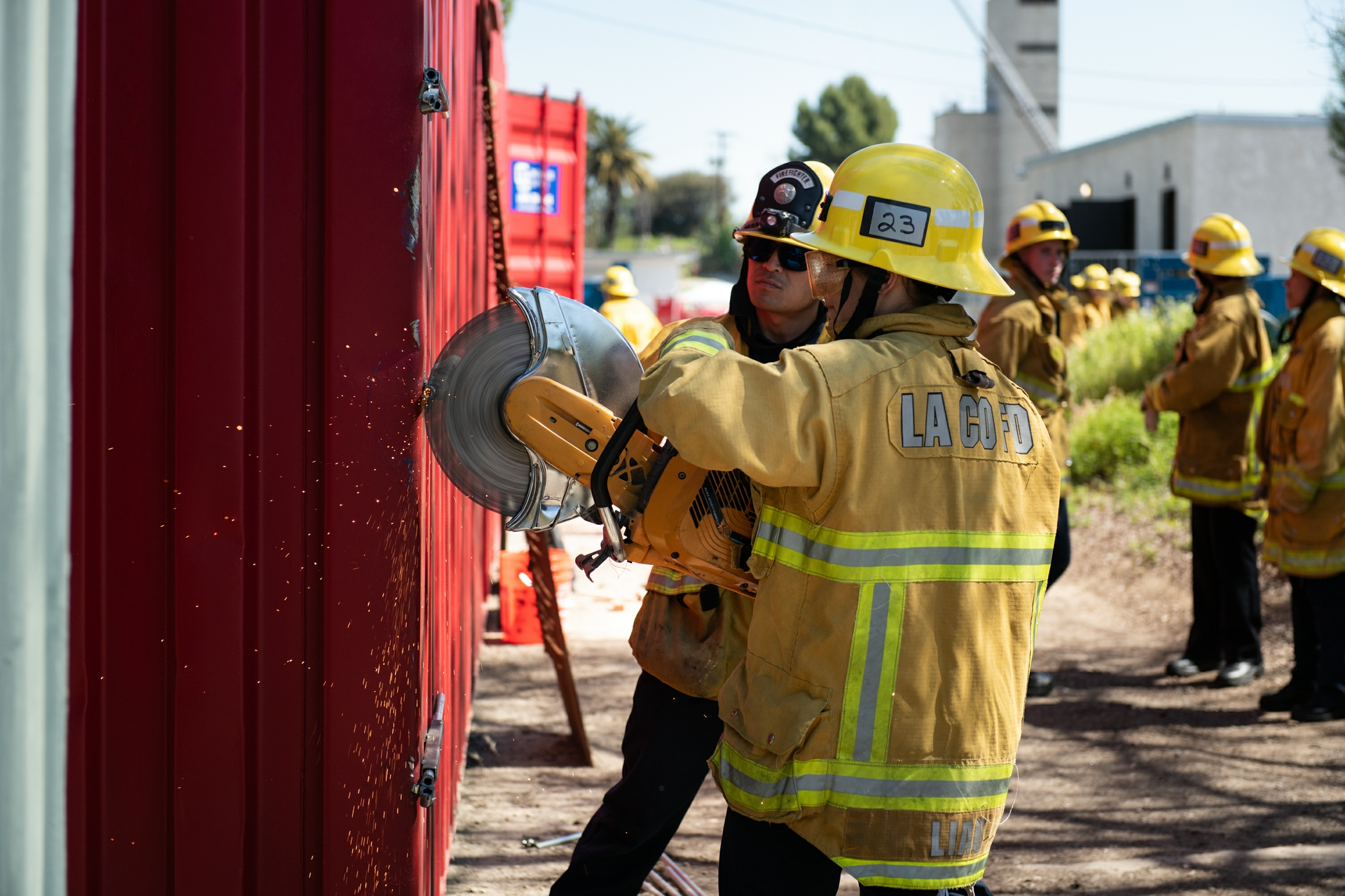 Participants learn about tools at the LACoFD's Women's Fire Prep Academy.