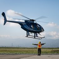 A helicopter arrives at SCE Air Operations in Chino for the wire safety seminar.