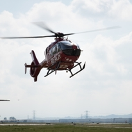 A REACH helicopter prepares to land at Chino Airport.