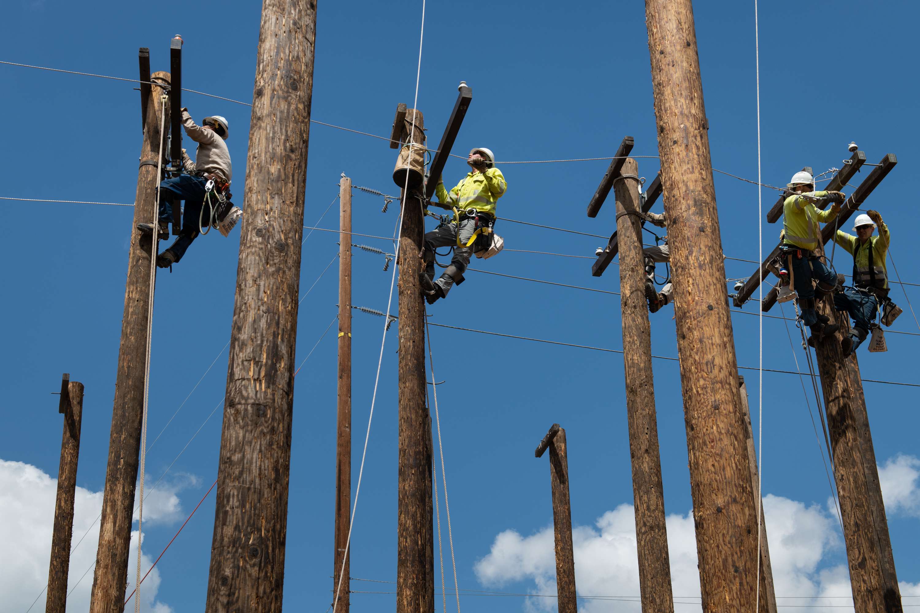 Apprentices train on poles at SCE's lineman training center in Chino.