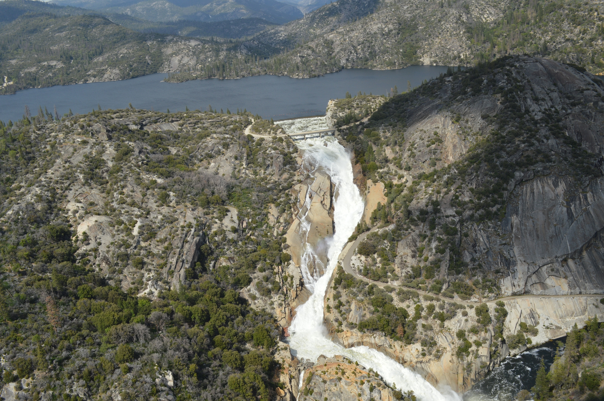 Water pours through SCE's Mammoth Pool Reservoir in the Sierra.