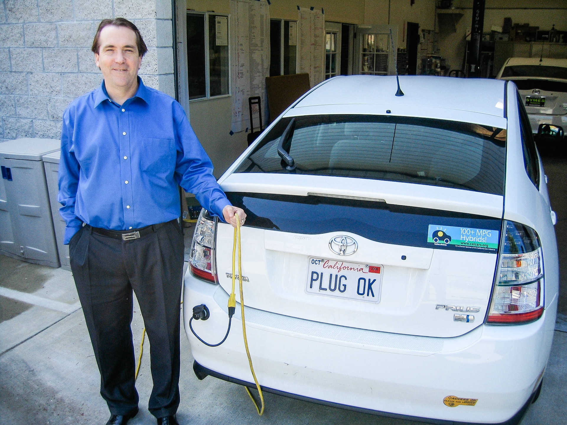 Dean Taylor shows off an early plug-in hybrid electric vehicle.