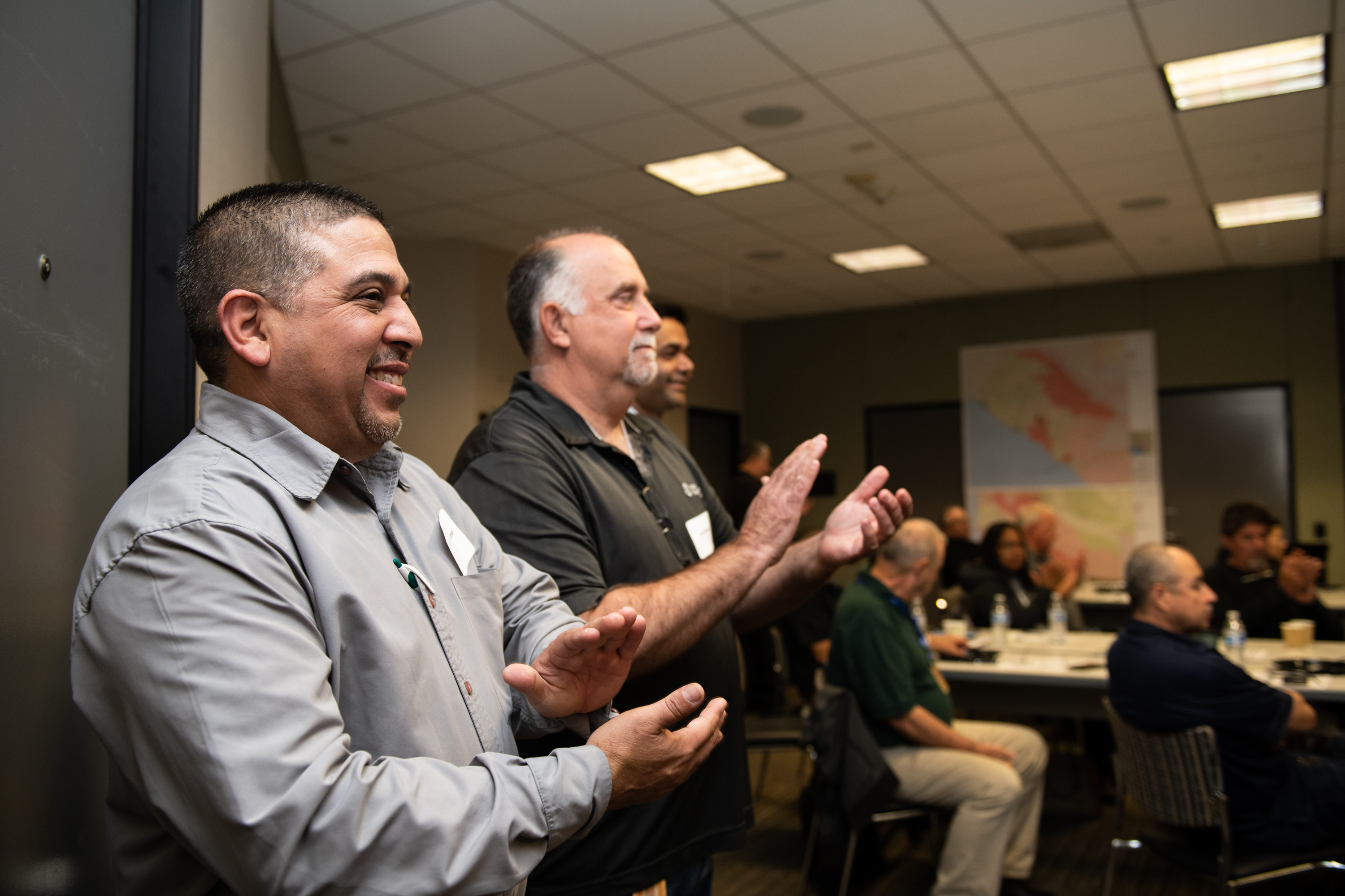 David Guzman, SCE Vegetation and Forestry Manager applauds at the end of  'Operation Santa Ana' presentation.