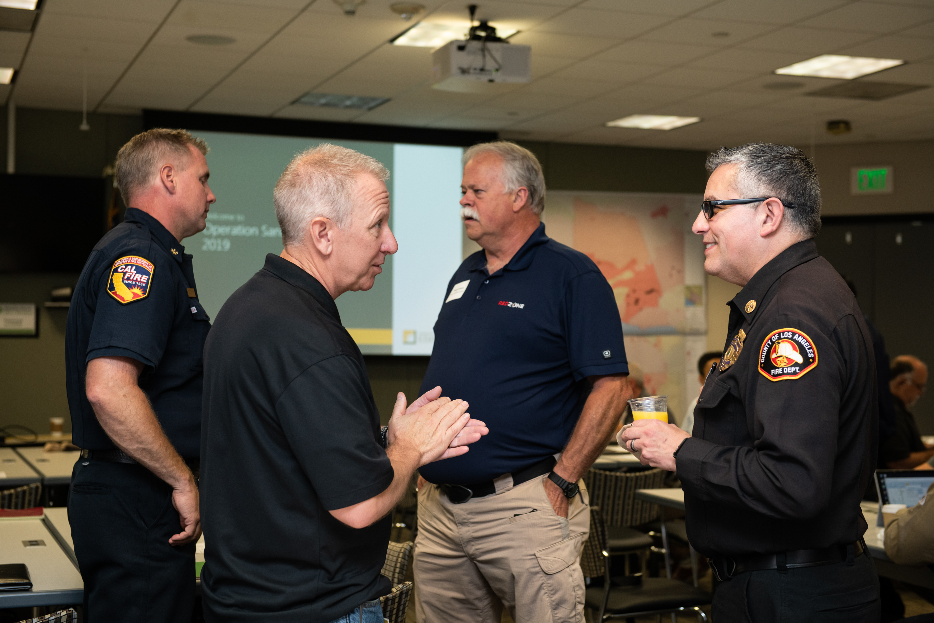 Troy Whitman, SCE Fire Management Officer discusses 'Operation Santa Ana' with J. Lopez,  Assistant Chief, L.A. County Fire Department
