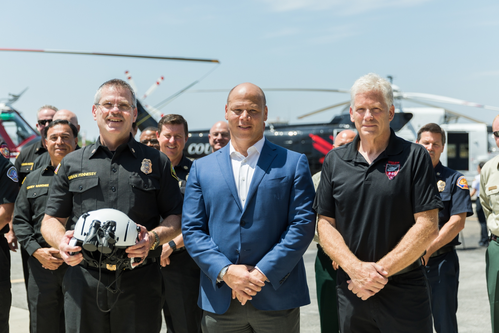 OCFA Fire Chief Brian Fennessy (left), Chris Thompson, SCE vice president of Local Public Affairs (center) and Wayne Coulson, CEO and president of Coulson Aviation, at an event announcing a water-dropping helicopter pilot project.