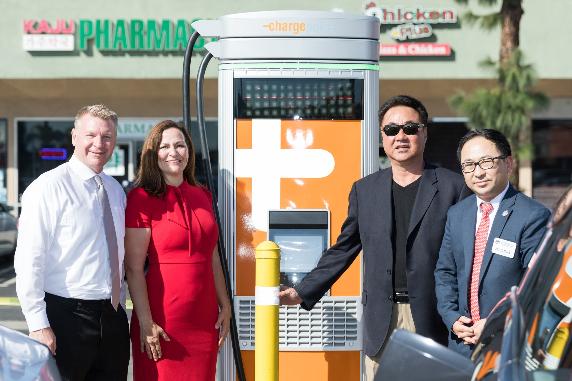 Katie Sloan, SCE director of eMobility and building electrification, is joined by Garden Grove Mayor Steven R. Jones, CNT Properties President Charles Lee and Korean American Chamber of Commerce of Orange County President Ho-El Park.