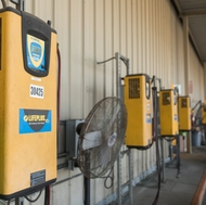 A row of chargers at SCE's Irwindale warehouse stand by to charge the company's electric forklifts.