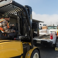 Mauro Delgado, an SCE material handler, loads some materials using one of the new electric forklifts.