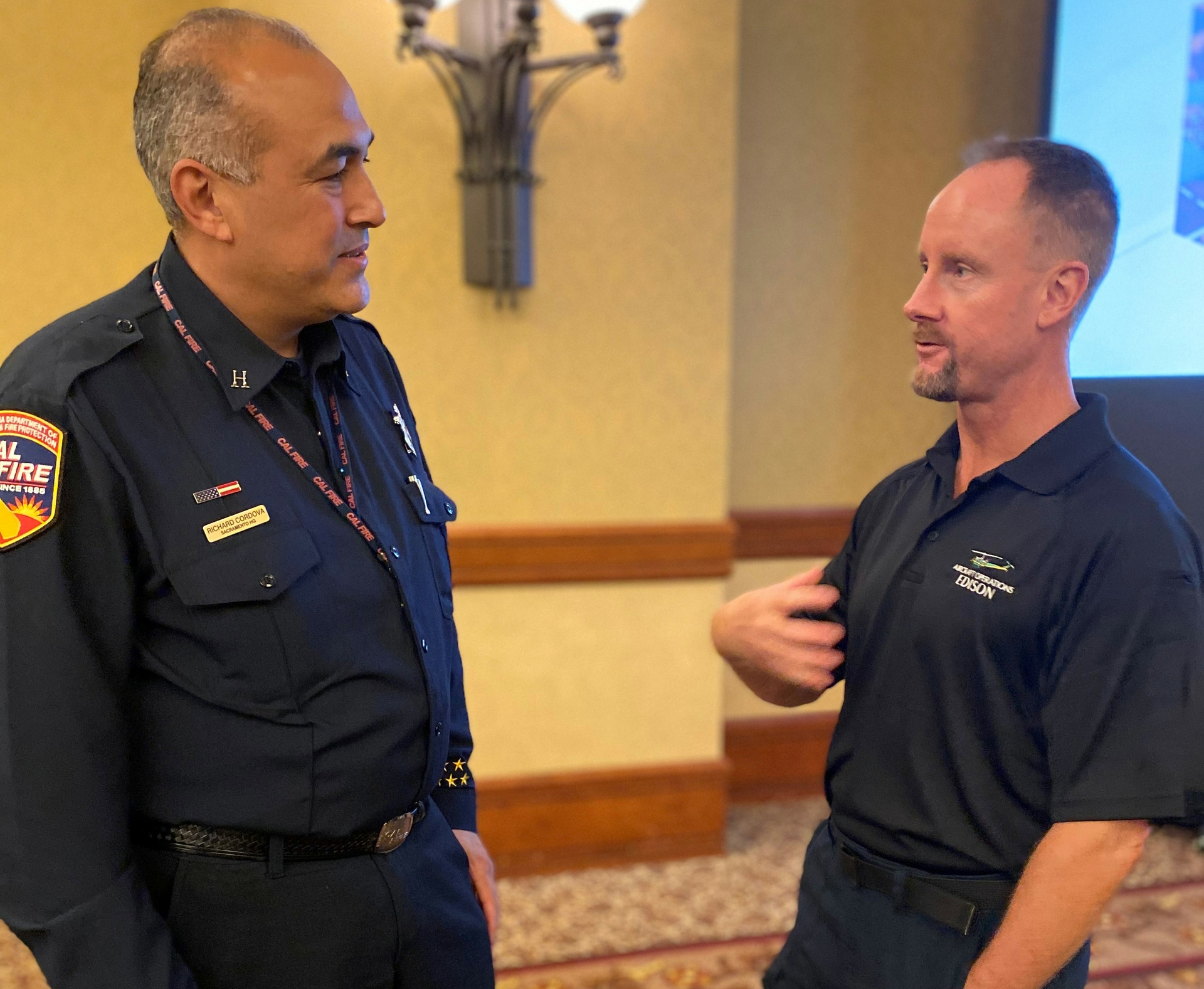 "SCE Air Ops chief pilot Torbjorn ""TC"" Corell speaks with Richard Cordova, CAL FIRE PIO, at the recent Aviation Safety Conference in Sacramento."