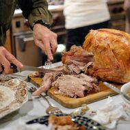 Turkey and their sides are best cooked in homes that have working fire extinguishers and smoke detectors if anything goes wrong.
