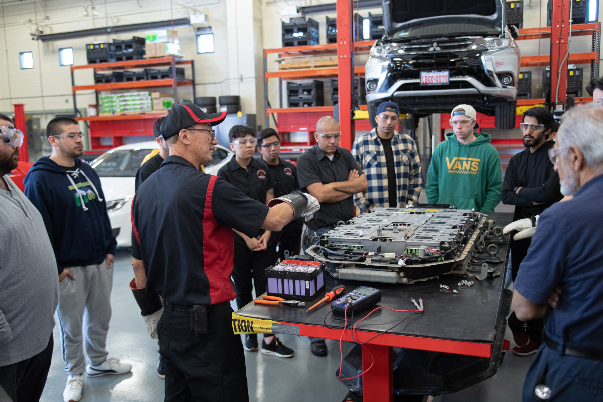 Students learn how to service electric cars and heavy-duty electric vehicles in Long Beach City College's Advanced Transportation Technology Program.