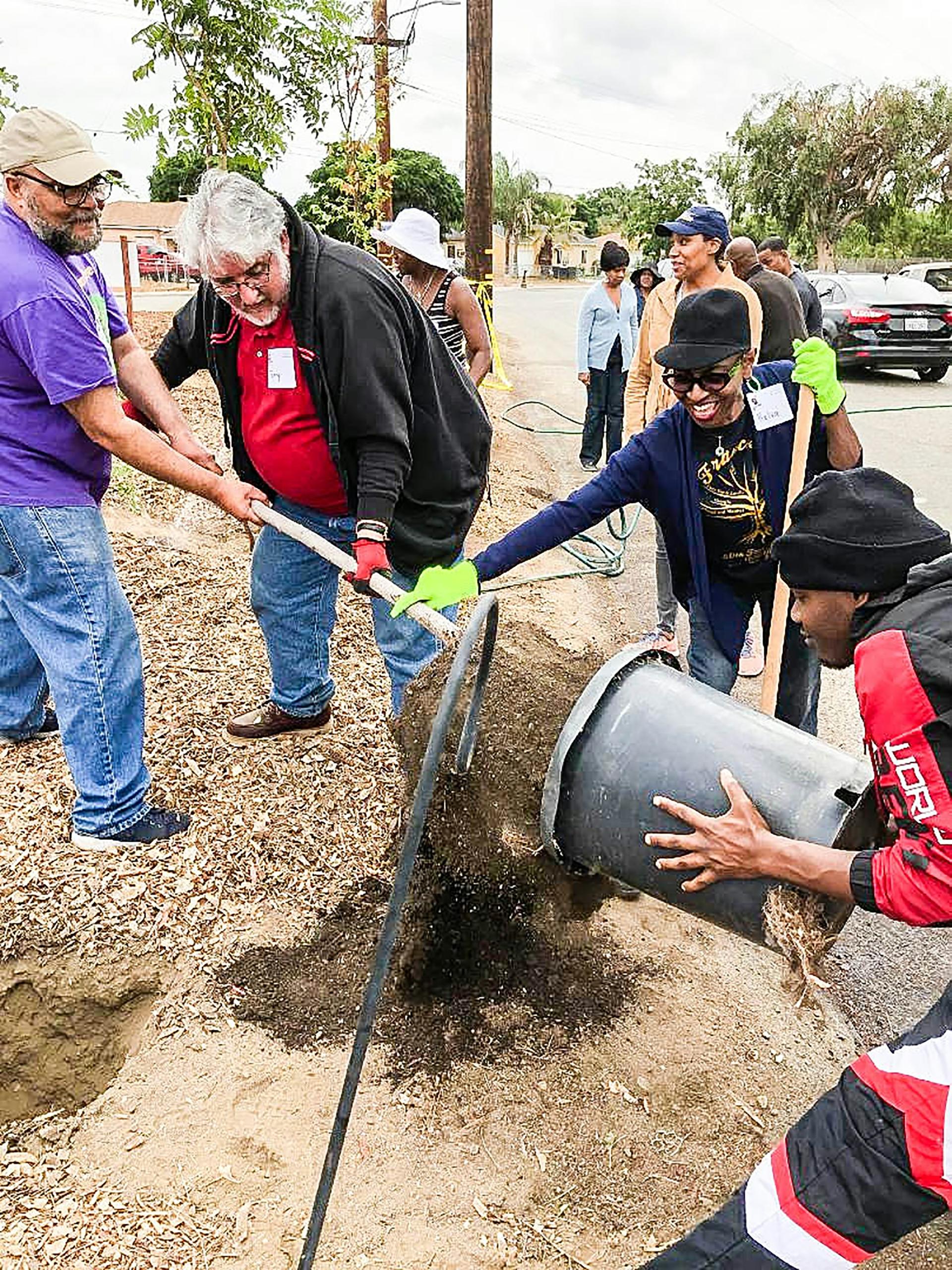 SistersWe volunteers plant a tree at Muscoy Community Garden in San Bernardino.