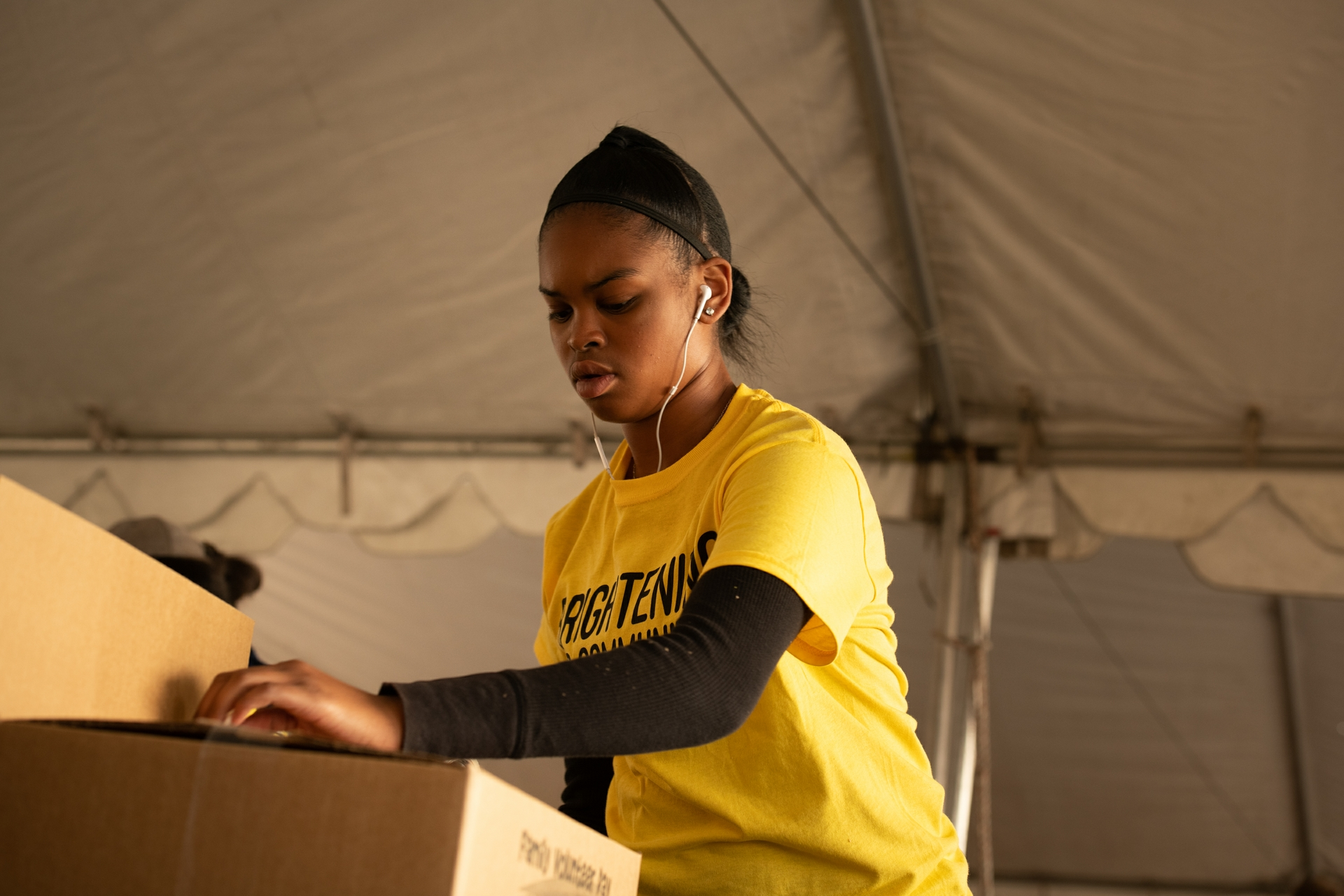 A volunteer helps pack boxes at a previous food bank volunteer event for SCE employees and their families.