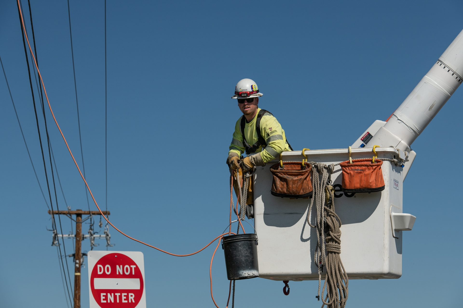 An SCE lineman in a bucket truck during a covered conductor installation.