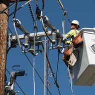 An SCE lineman helps install covered conductor.