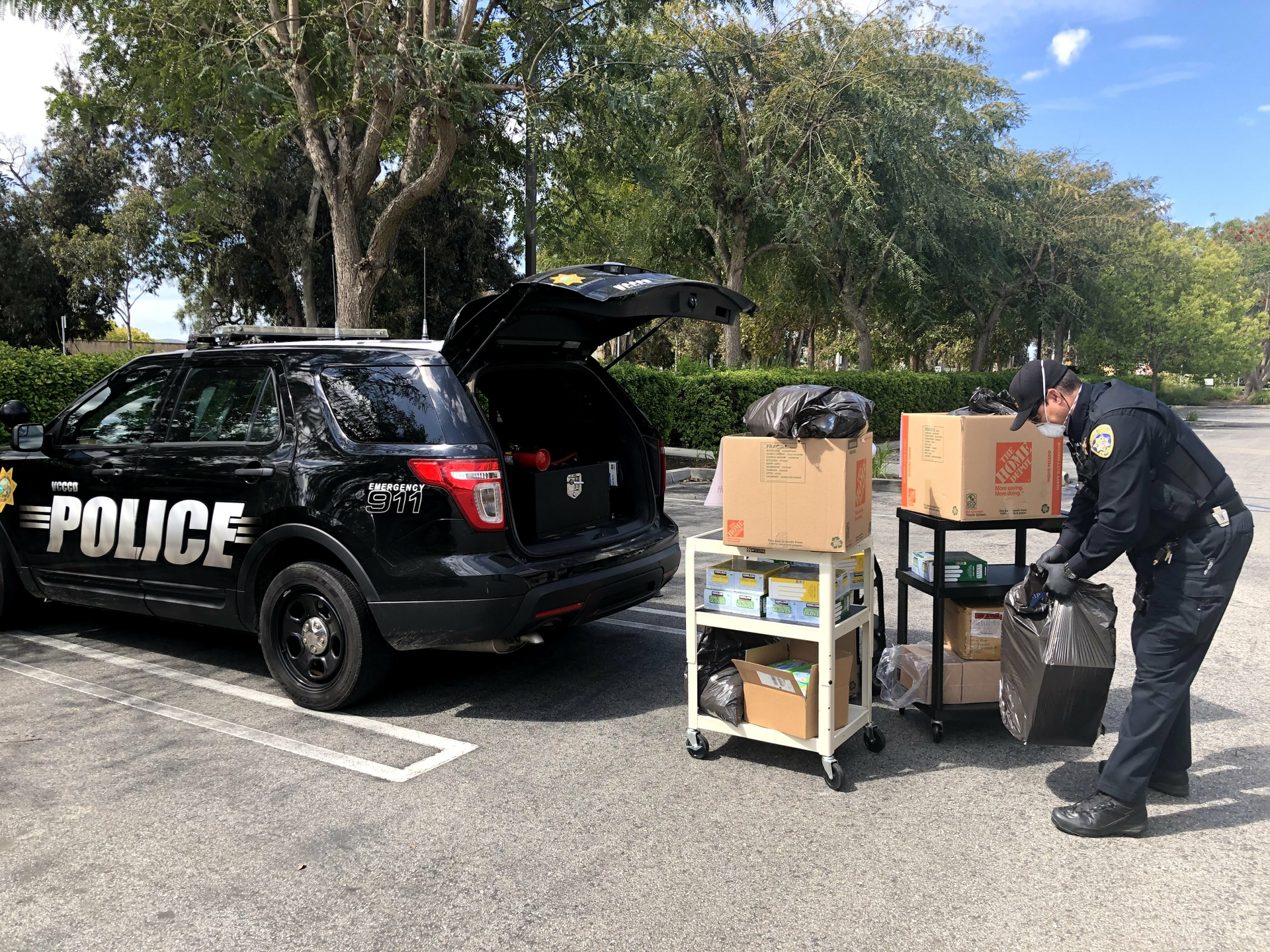 A Ventura County officer delivers 91 boxes of nitrile sterile gloves and a case of boot covers and critical gowns for local doctors as well as four cases of industrial protective eyewear for emergency workers.