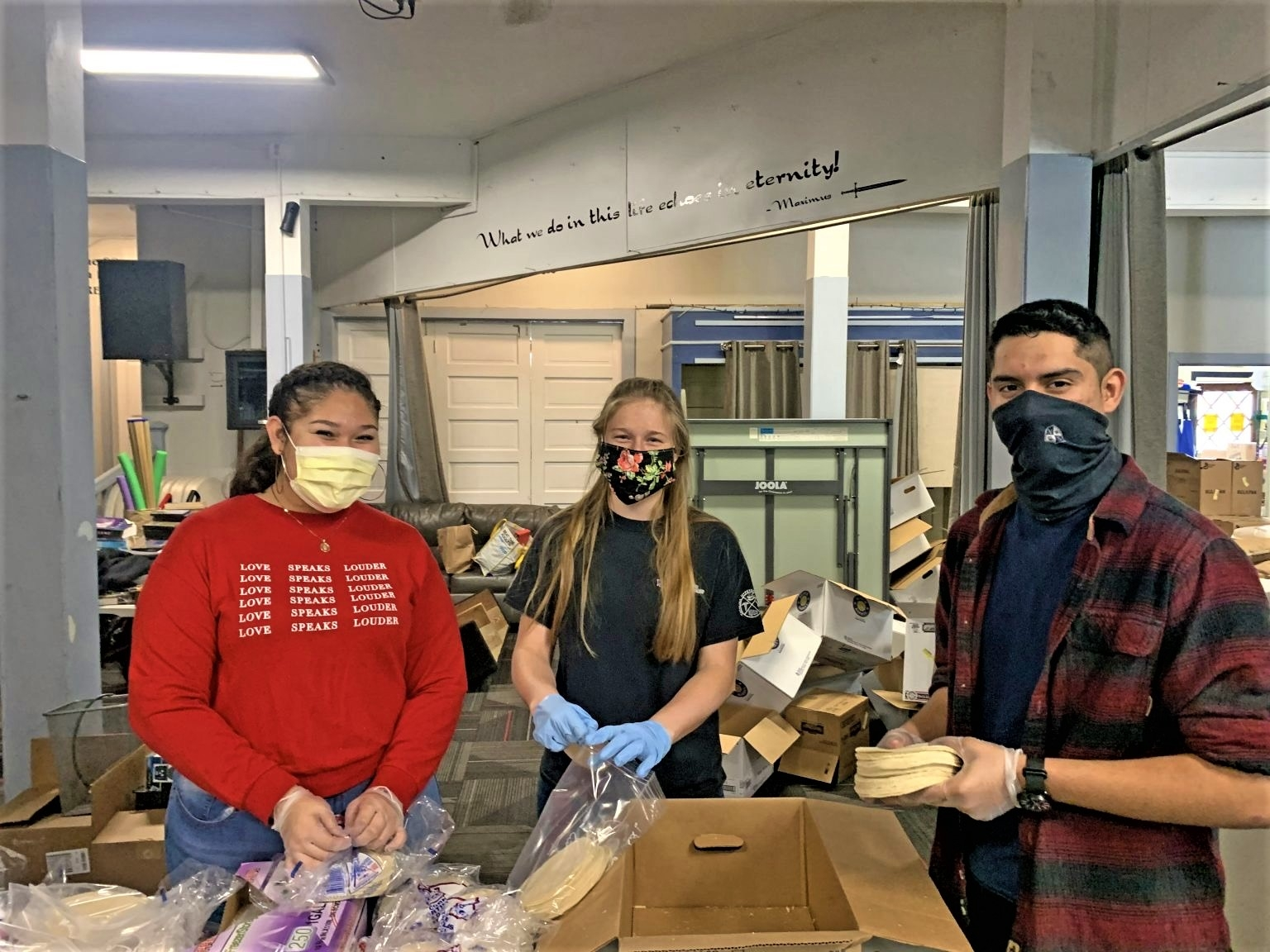 2020 Edison Scholar Daniel Silva Rios  (right)  and other volunteers help divide and distribute food bags at a community church to give to those in need on Catalina Island during COVID-19.