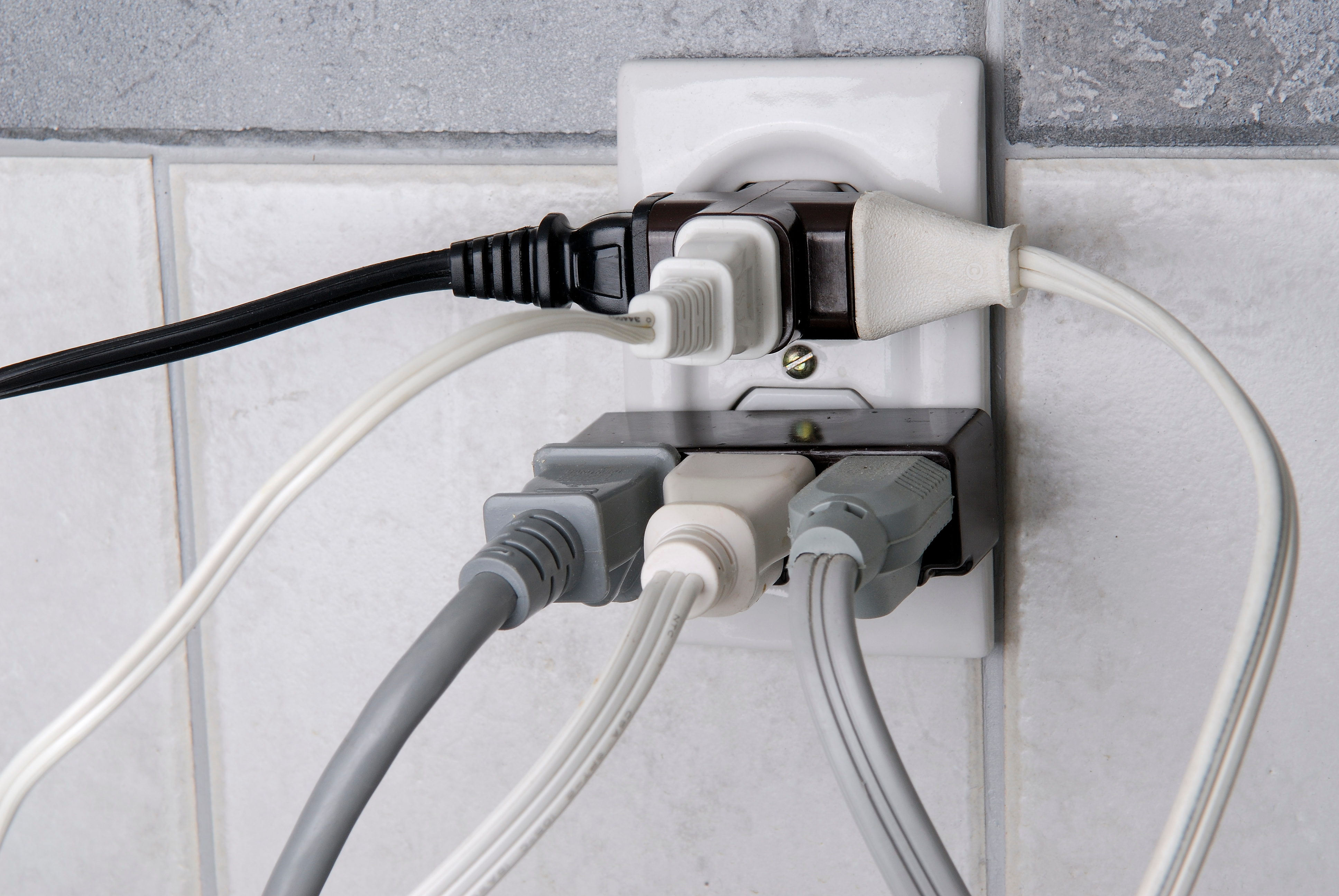 To eliminate a fire hazard, power outlets should not be overloaded, and surge protectors should be used when possible.