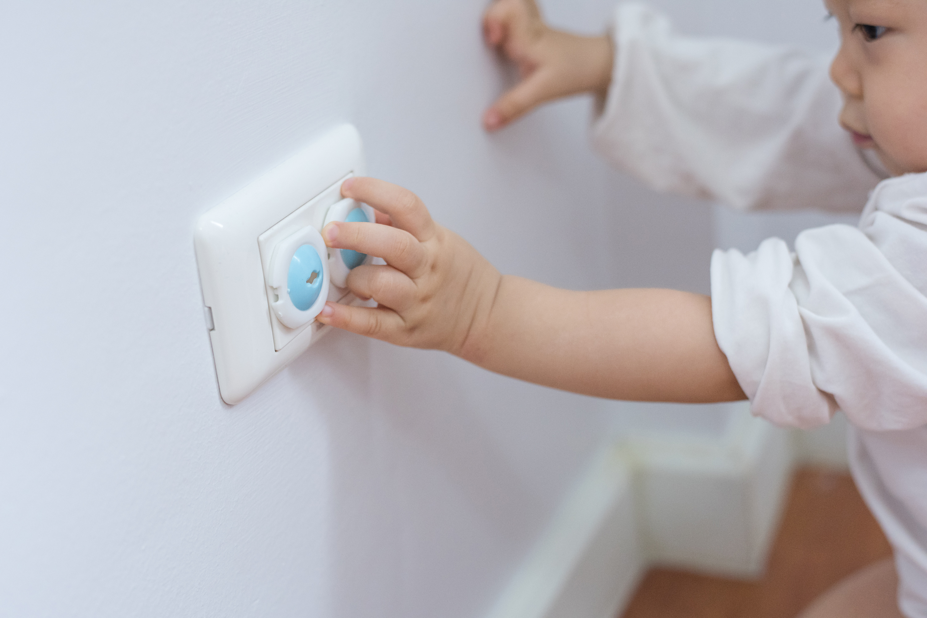 Child-proofing outlets with plastic covers and safety shutters is crucial since nearly seven children a day are injured tampering with outlets.