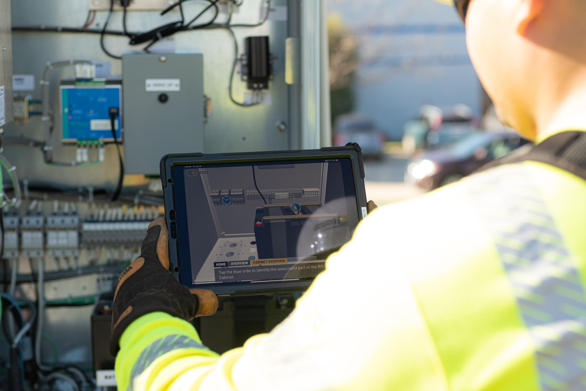 An SCE lineman uses AR technology to help diagnose an electrical equipment issue.