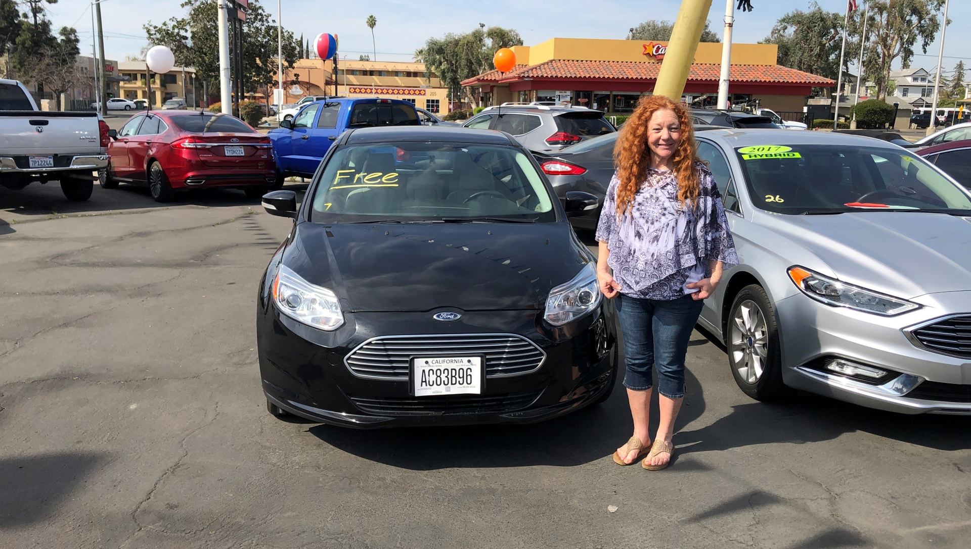 Connie Brown of Bakersfield turned in her 1994 BMW 325 for a used Ford Focus Electric with the help of nonprofit Valley CAN.