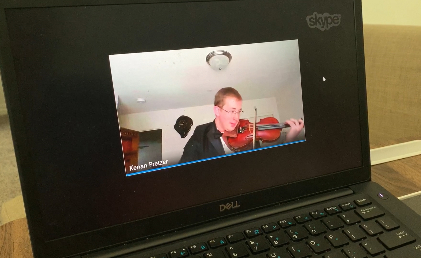 SCE employee Kenan Pretzer holds virtual violin recitals for his colleagues and local community.