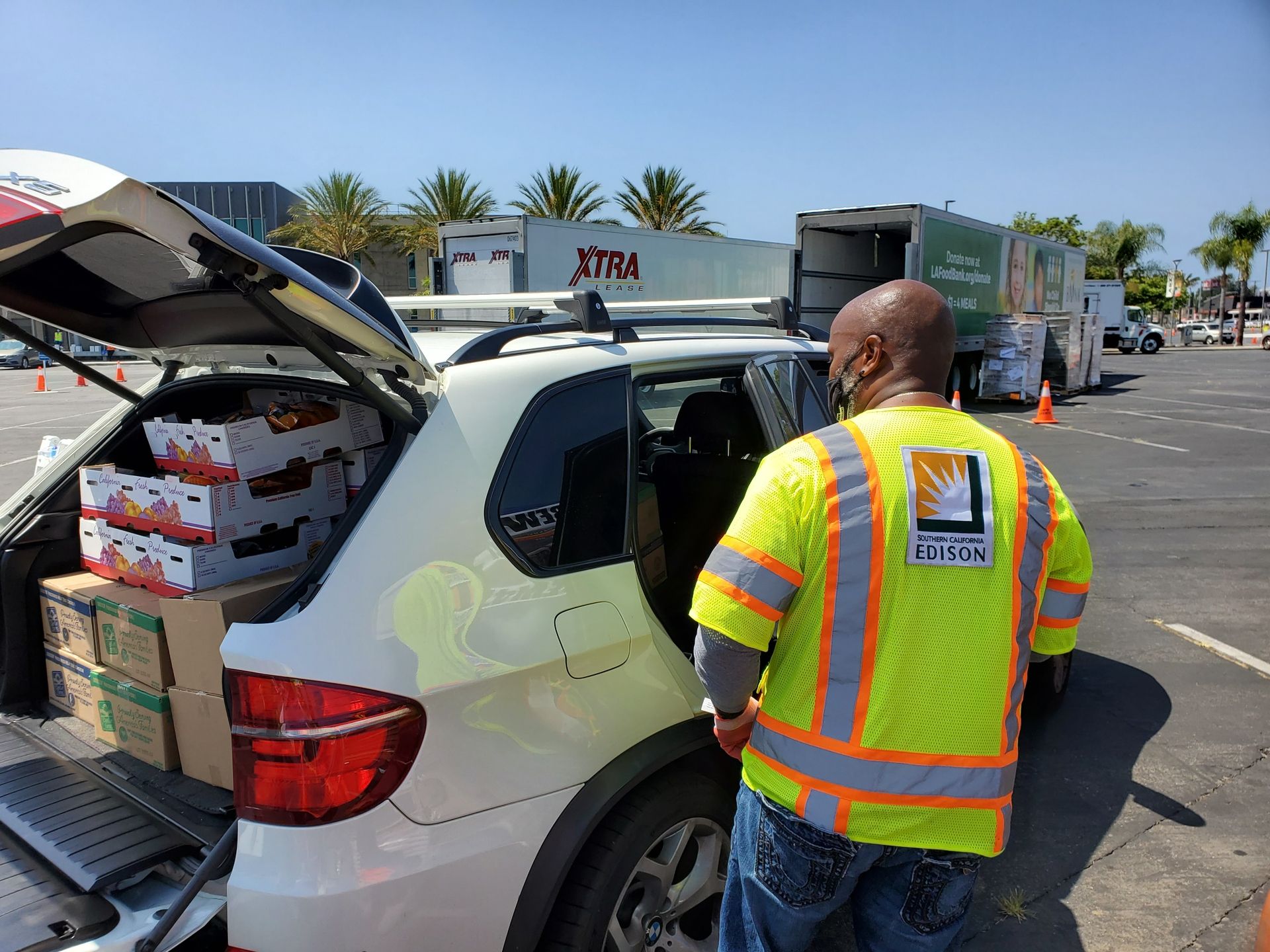 IBEW 47 members help load food boxes filled with various meal items, including fresh vegetables, chicken patties and spaghetti.
