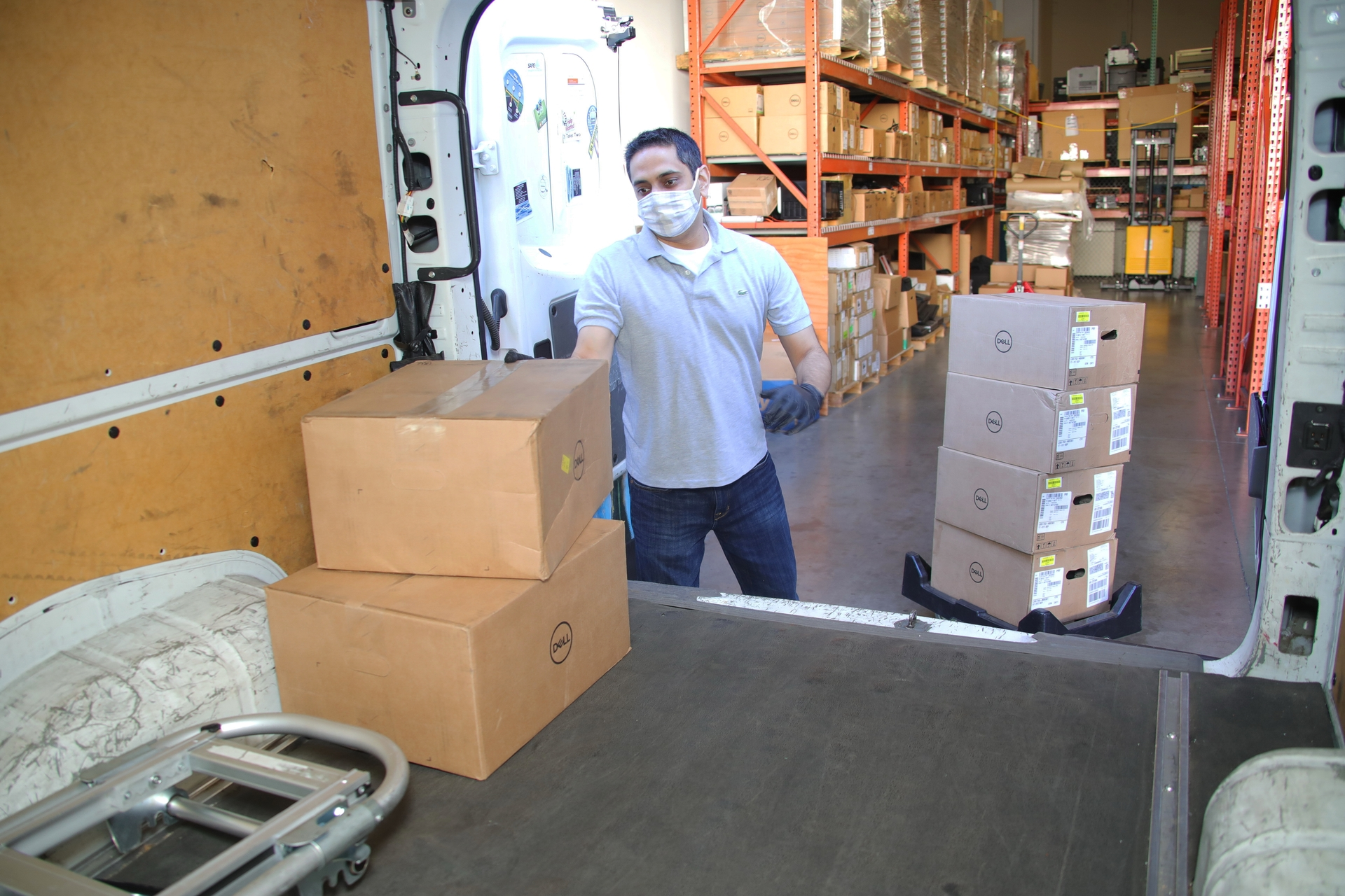 Sanjay Nangia, SCE principal manager in IT Operations, loads boxes of refurbished laptops for donation onto a truck.
