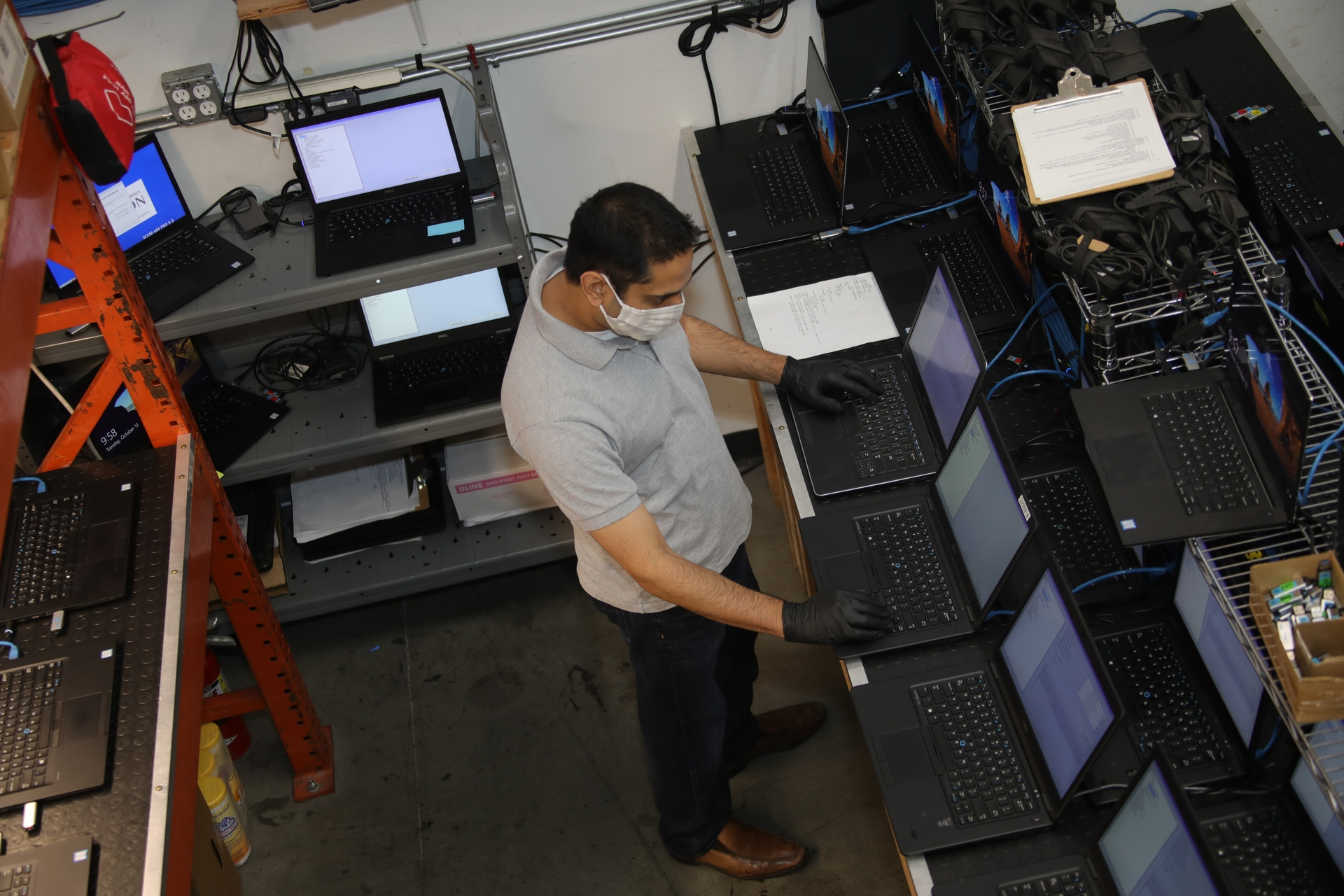 Sanjay Nangia, SCE principal manager in IT Operations, works on refurbished laptops.
