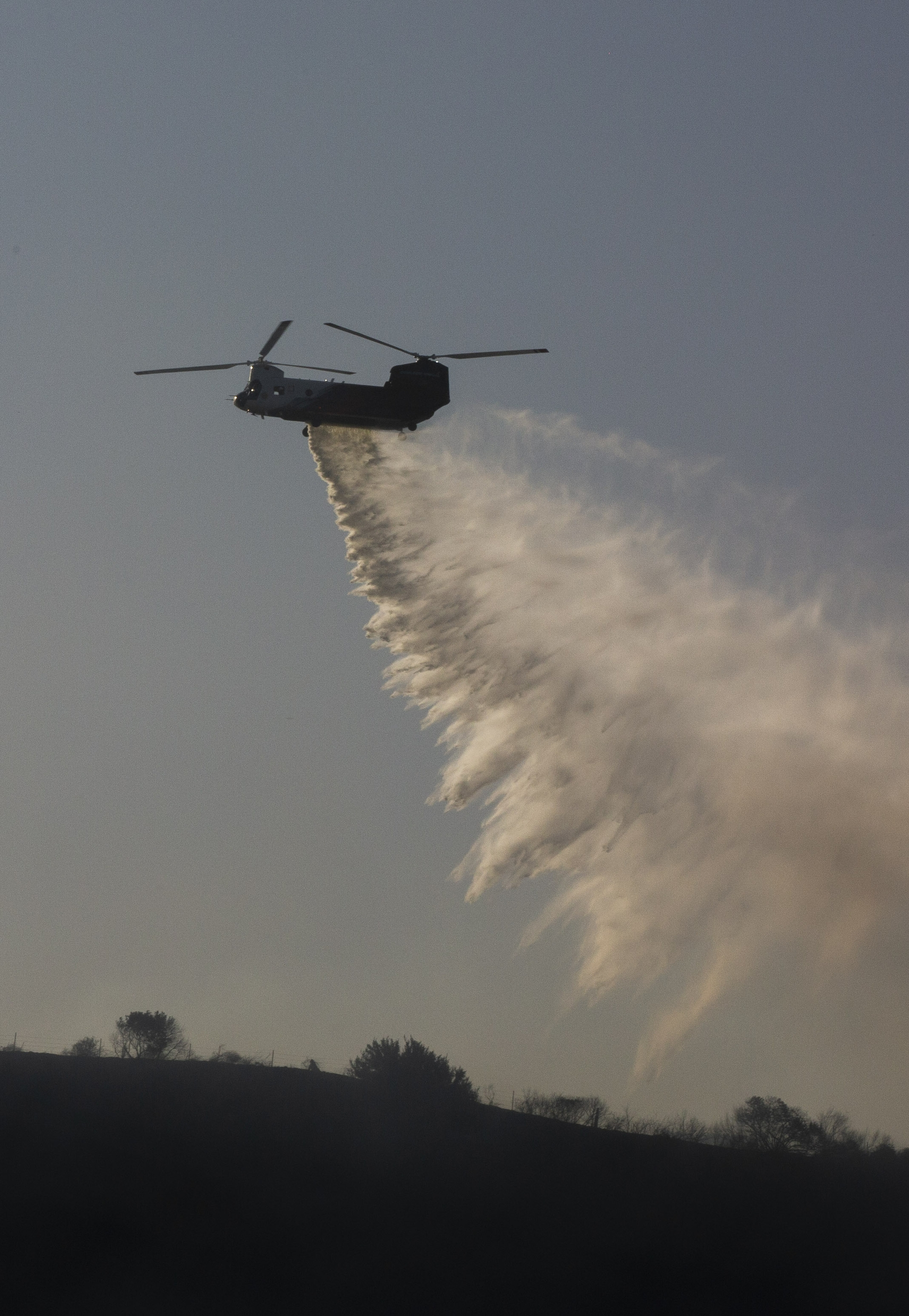 The Coulson-Unical CH-47 helitanker used by OCFA can drop  3,000 gallons of water in a single pass.