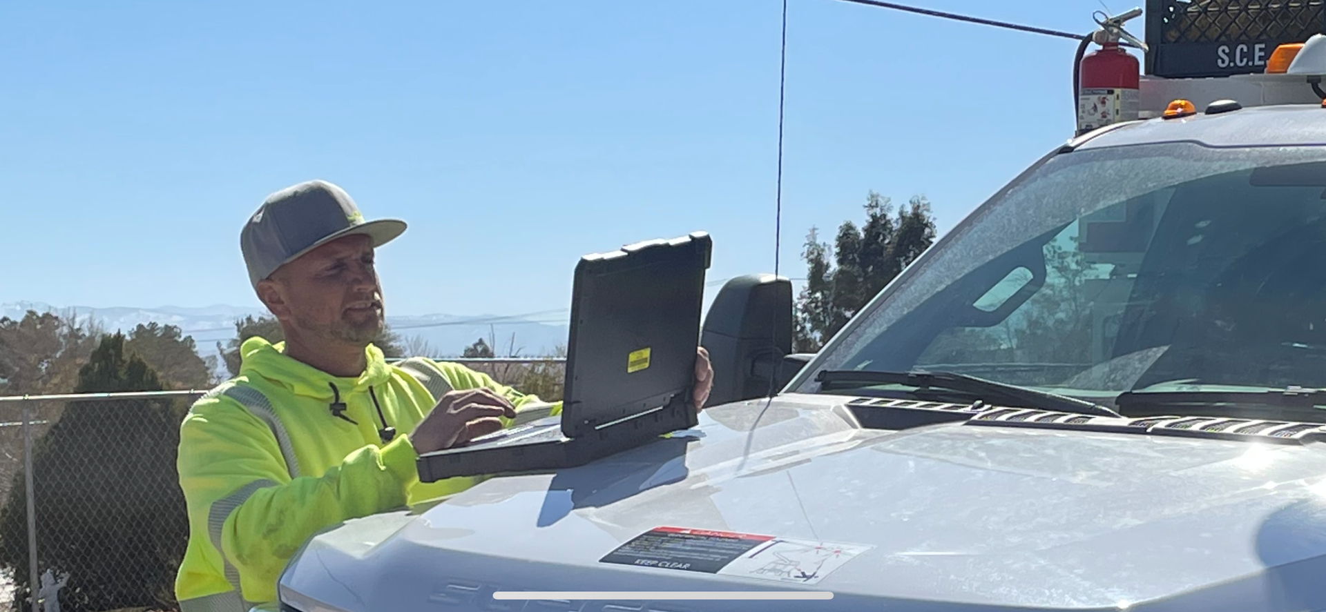 Brandon Wright, SCE troubleman and inspector, watches a live video feed of a drone inspecting electrical equipment.