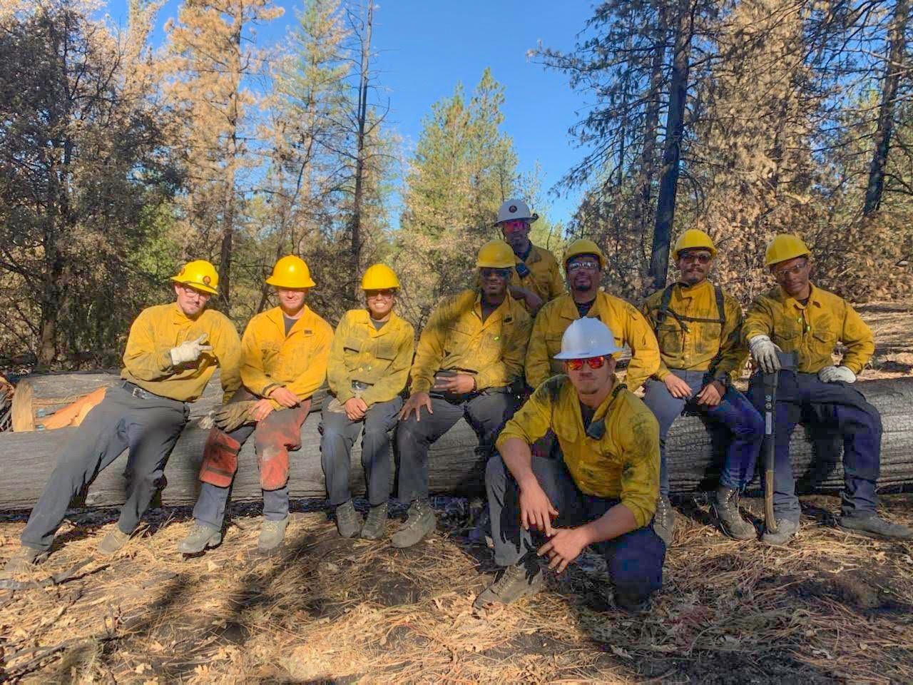A Forest and Fire Recruitment Program crew takes a break during a fire prevention/defensible space project.