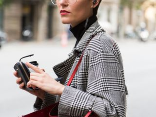 Stylish Short Haired Business Woman Commuting Between Meetings On A Busy City